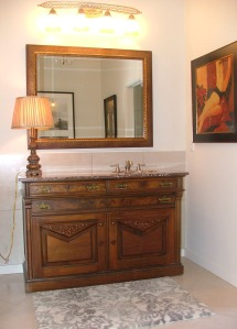 Here is the antique dresser with gorgeous marble top that I turned into a vanity for the master bath. It was much cheaper than purchasing a new vanity with a stone top and is so much more interesting.