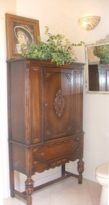 This antique highboy armoire makes an excellent linen cabinet. Stylish, beautiful and unique.