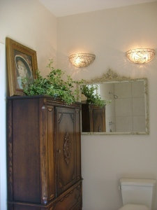 The sconces and mirror perfectly complement the antique armoire.