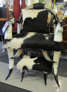 Chair and stool with hides and horns.